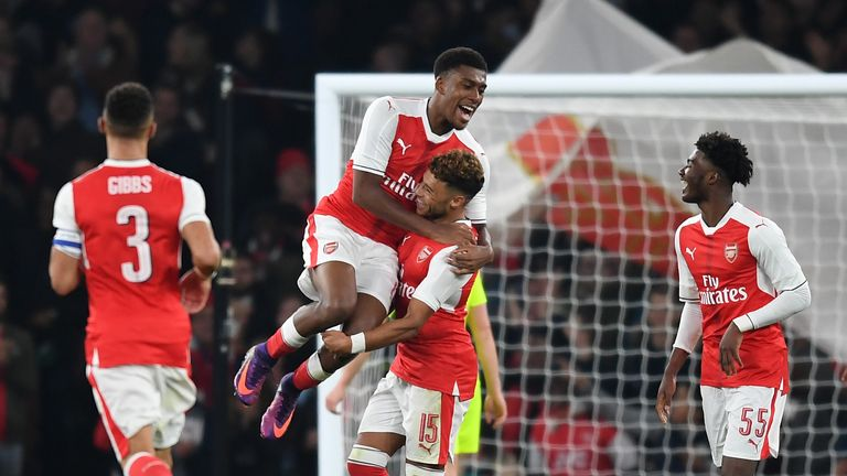 Alex Oxlade-Chamberlain mobbed after scoring for Arsenal