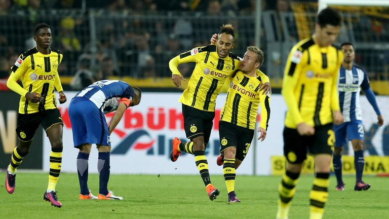 Pierre-Emerick Aubameyang is congratulated after scoring the equaliser for Borussia Dortmund