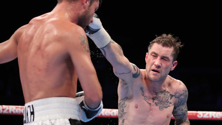 Burns lands a punch on Relikh on his way to a successful defence of his WBA super-lightweight world title