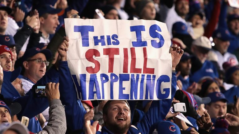 Fans cheer during Game Five of the 2016 World Series between the Chicago Cubs and the Cleveland Indians