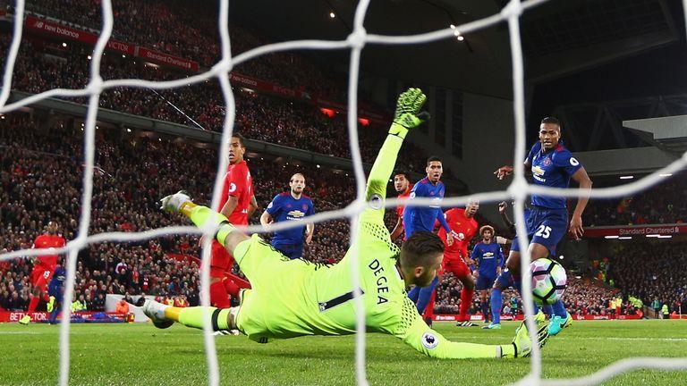 David de Gea gets down to save Emre Can's goal-bound shot