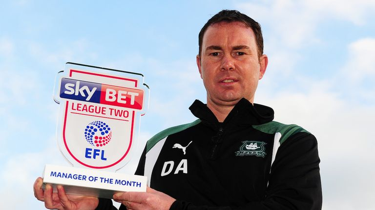 Plymouth boss Derek Adams with his award (Pic: Harry Trump/JMP)