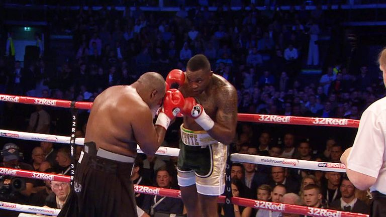 Dillian Whyte sits on his ropes as Lewison marches forward