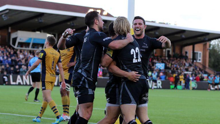 Newcastle players celebrate Joel Hodgson's try against Bristol