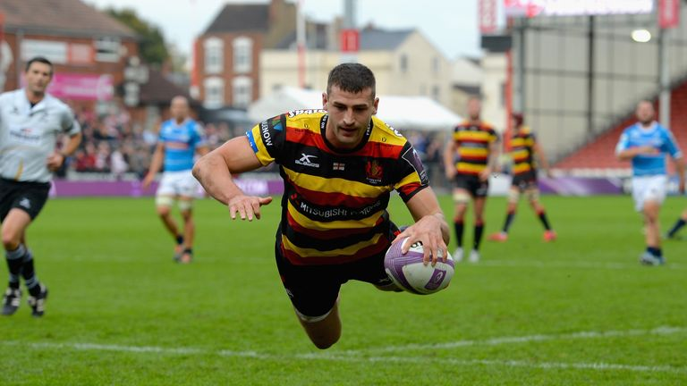 Jonny May dives over for one of Gloucester's tries