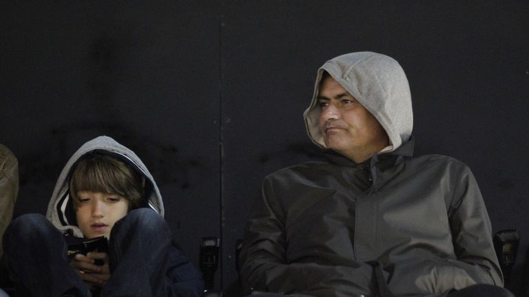 Jose Mourinho watches a game at Craven Cottage with his son