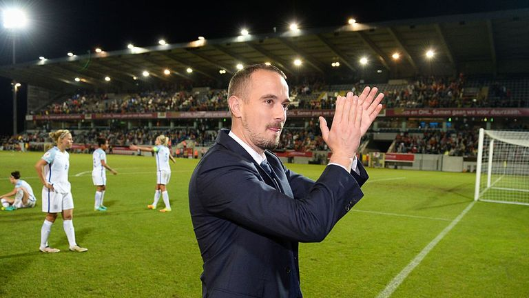 England's head coach Mark Sampson celebrates after winning a Euro 2017 qualifier against Belgium