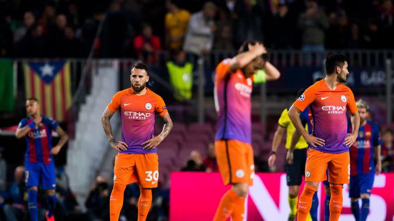 Man City's players look dejected in Barcelona
