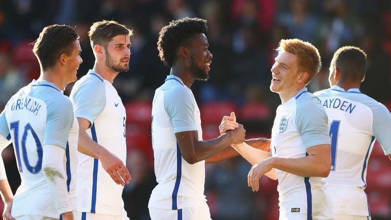 Watmore (right) celebrates with Onomah and team mates