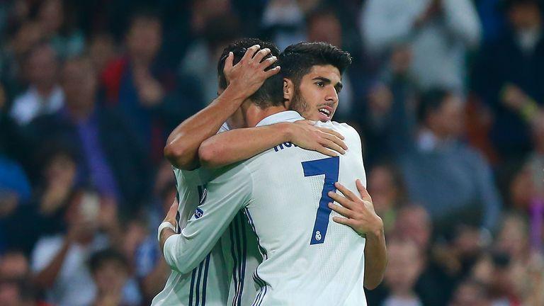 Marco Asensio celebrates scoring his team's third goal against Legia Warsaw with Cristiano Ronaldo