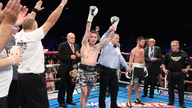 Ricky Burns bears Kyril Relikh to retain his WBA super-lightweight world title