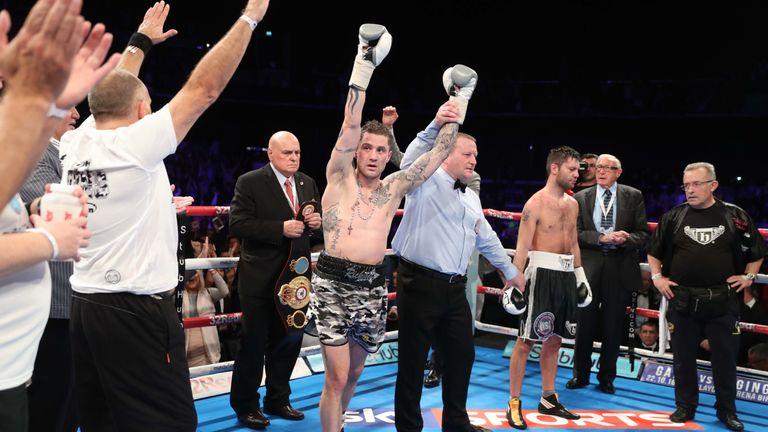 Ricky Burns bears Kyril Relikh to retain his WBA super-lightweight world title