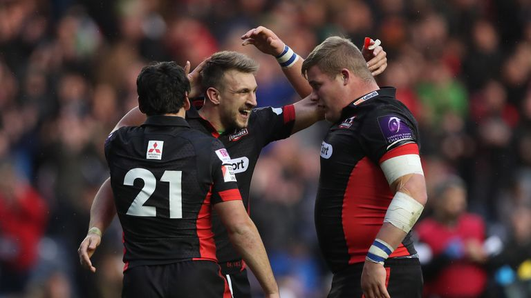 Tom Brown (C) earns the congratulations of Edinburgh team-mates Sam Hidalgo-Clyne (L)  and Murray McCallum