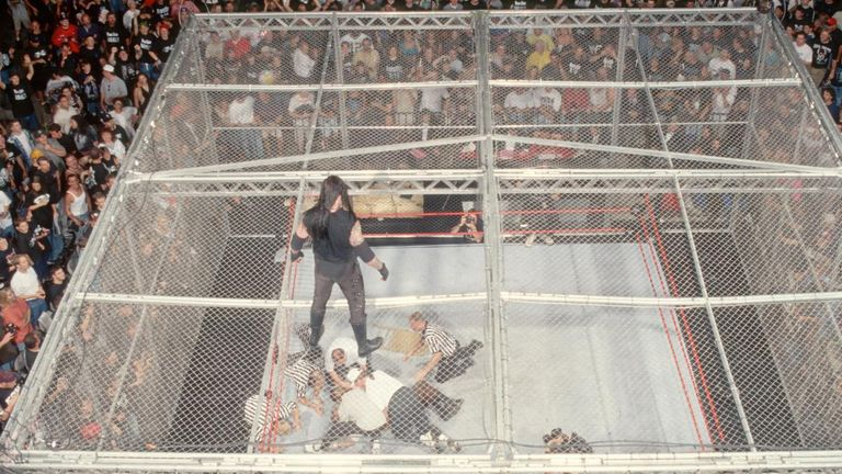 The Undertaker gazes at a stricken Mick Foley in 1998
