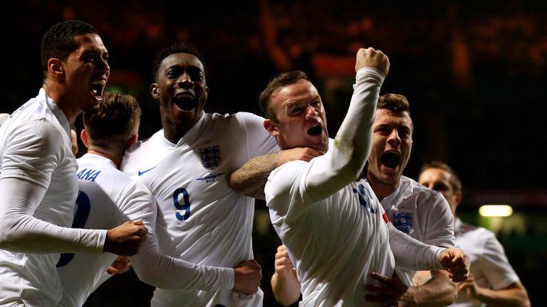 Wayne Rooney celebrates scoring England's second goal against Scotland in November 2014