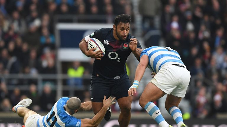 Lucas Noguera of Argentina (R) and Santiago Cordero of Argentina (L) attempt to stop Billy Vunipola