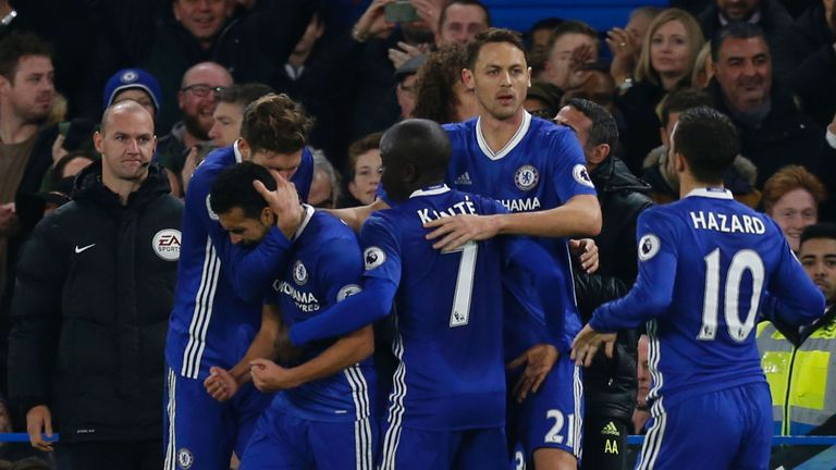 Chelsea midfielder Pedro (centre) is congratulated after equalising for Chelsea