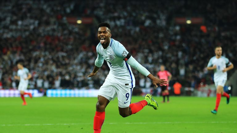 Daniel Sturridge wheels away in celebration after putting England ahead