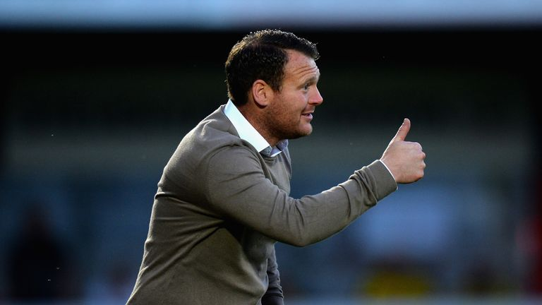 Stevenage's Darren Sarll is hoping for a a slip up from Carlisle or Blackpool.