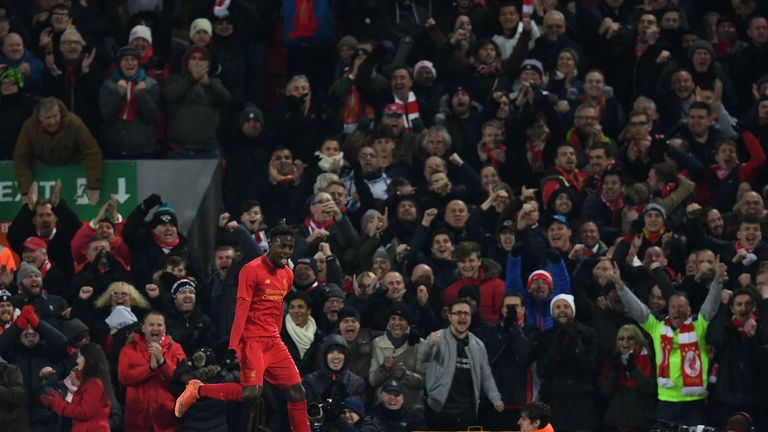 Liverpool's Belgian striker Divock Origi celebrates scoring his team's first goal