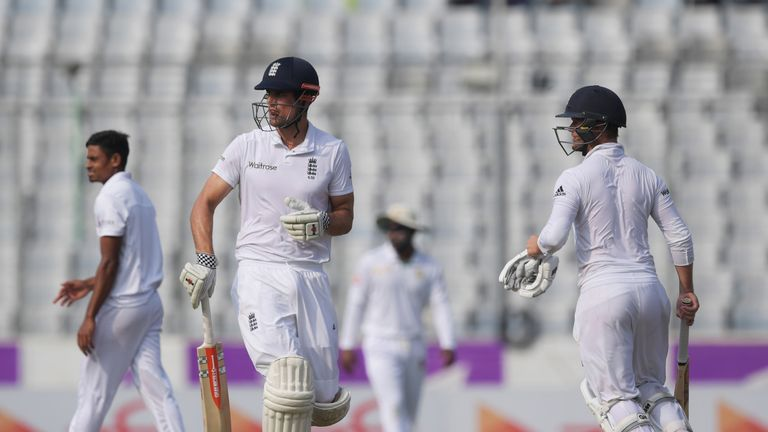England's captain Alastair Cook (L) opened with Duckett in Bangladesh