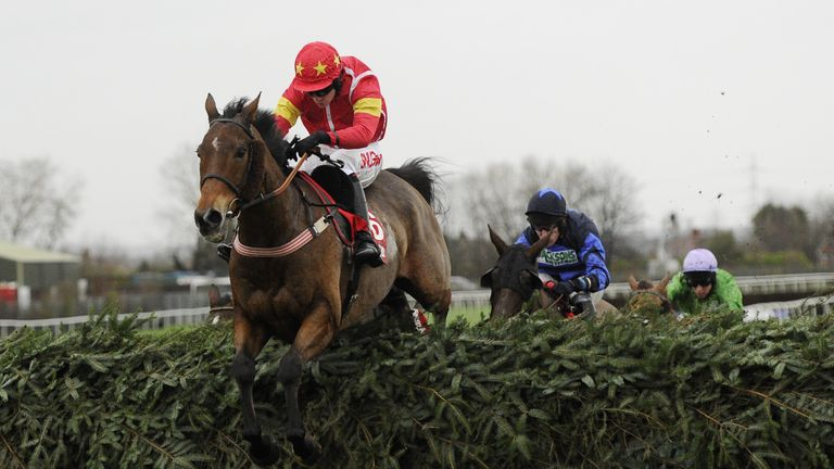 Highland Lodge and Henry Brooke jump the final fence as they win the Betfred Becher Chase in 2015.