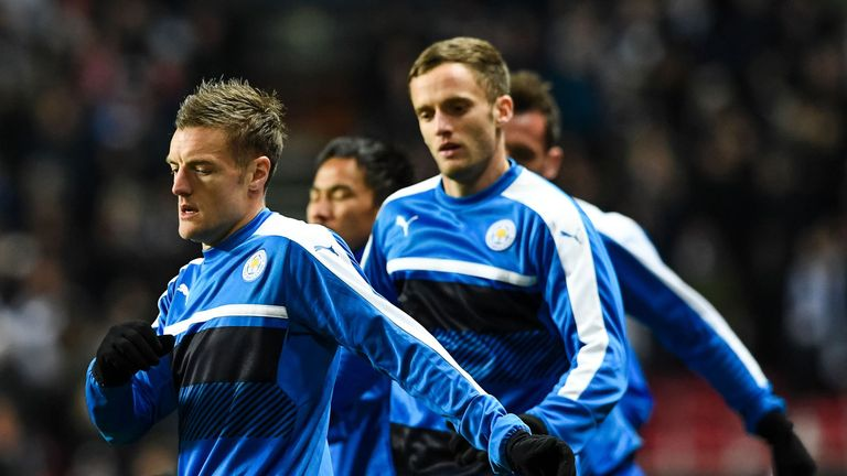 Leicester City's players warm up in the cold prior to kick off
