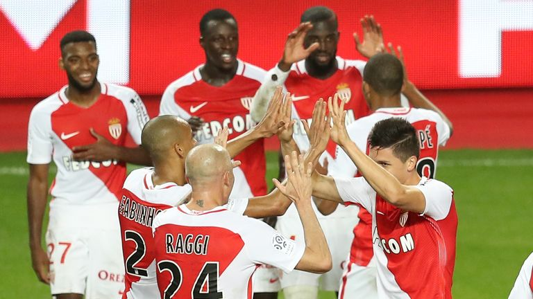 Monaco's Guido Carrillo (R) celebrates with teammates