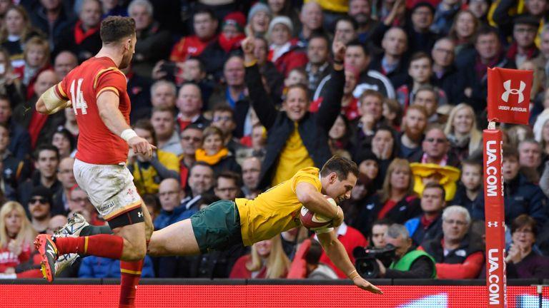 Bernard Foley dives over to score Australia's fourth try