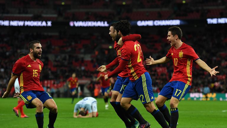 Spain celebrate Isco's late equaliser at Wembley on Tuesday evening