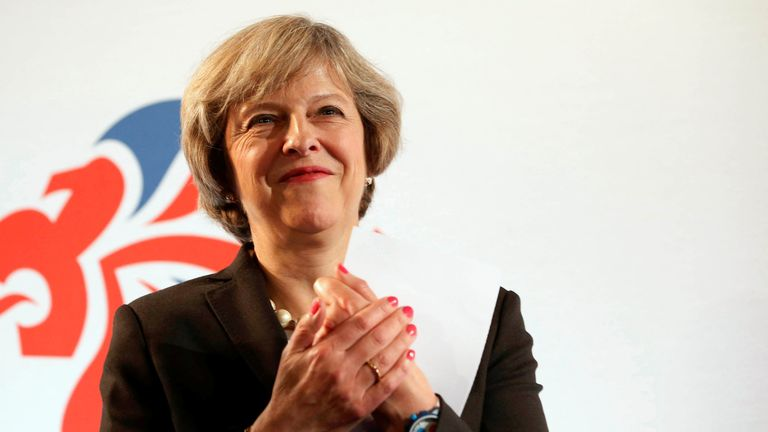 Prime Minister Theresa May has urged FIFA to allow poppies to be worn during England's clash with Scotland