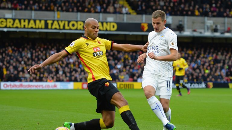 Watford's Younes Kaboul of Watford (L) tackles Marc Albrighton of Leicester