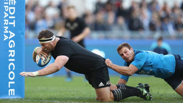 Wyatt Crockett of New Zealand bulldozes over