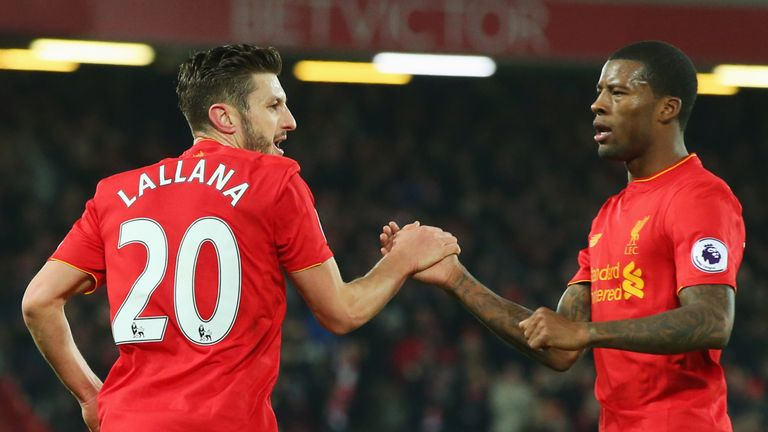 Adam Lallana celebrates with Georginio Wijnaldum after scoring the equaliser