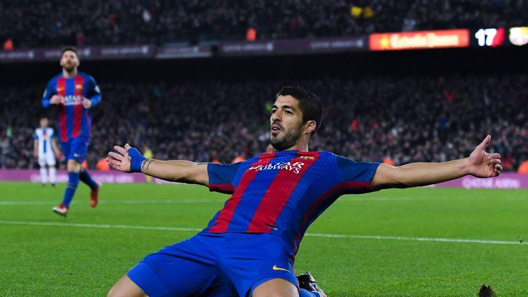 Luis Suarez celebrates another Barcelona goal