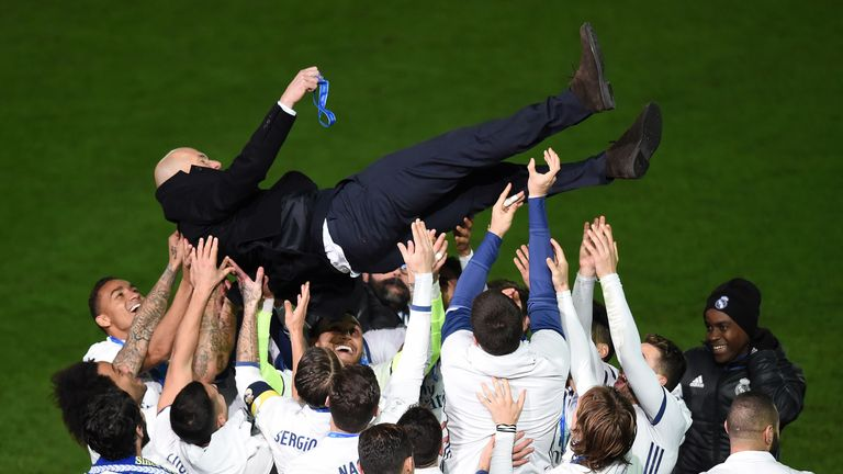 Zidane is thrown into the air by Real Madrid players after the presentation