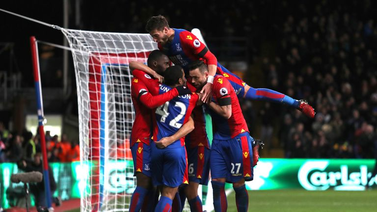 Christian Benteke celebrates with his team mates after scoring the third against Southampton