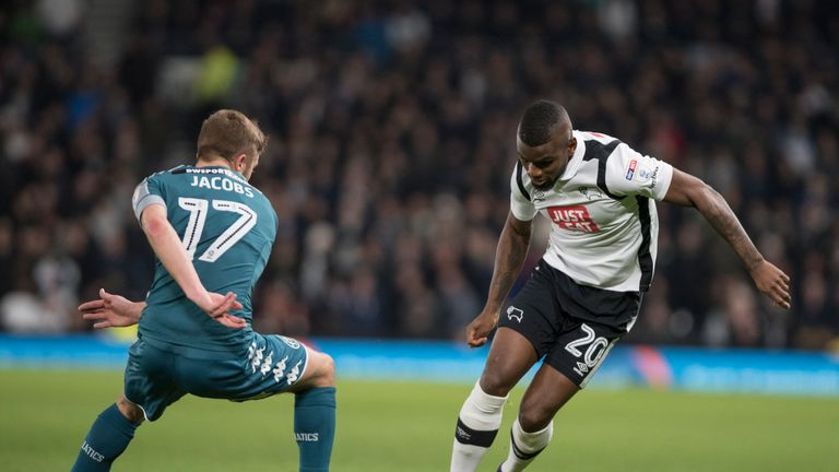 Derby's Abdoul Camara (right) takes on Michael Jacobs