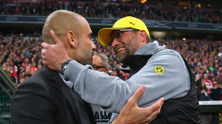 Pep Guardiola (left) exchanges pleasantries with Jurgen Klopp during their Bundesliga days
