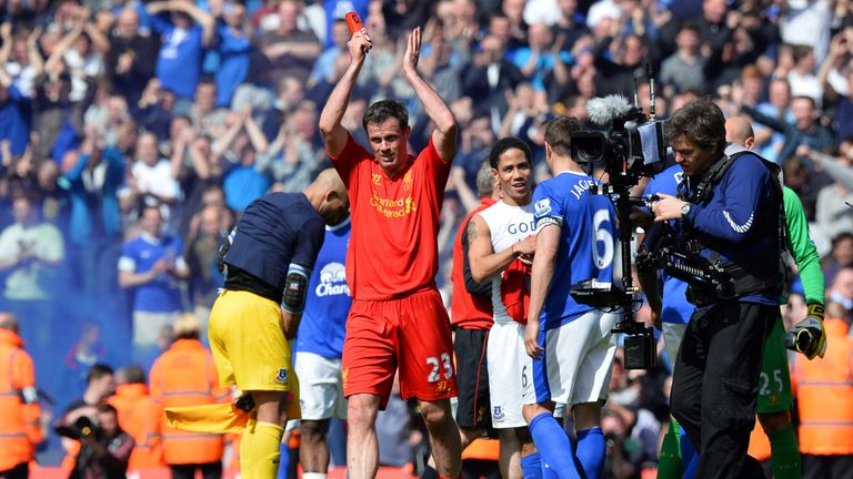 Carragher applauds the crowd after his final derby match