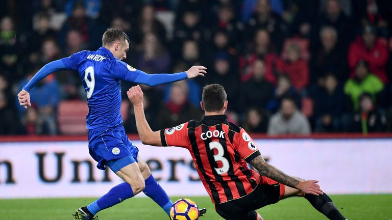 Jamie Vardy takes a shot on goal under pressure from Steve Cook