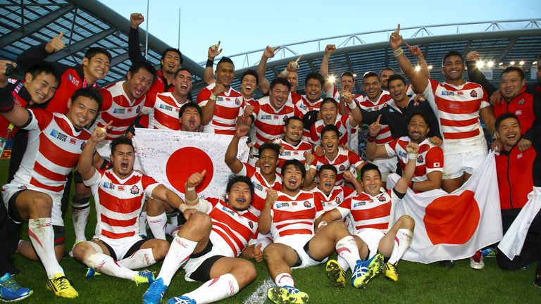 Japan celebrate their astounding win over South Africa at the 2015 Rugby World Cup