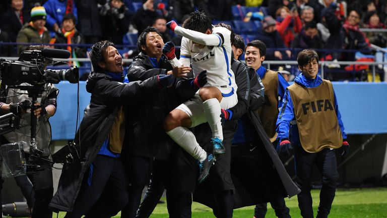 Kashima Antlers celebrate following the earlier penalty controversy