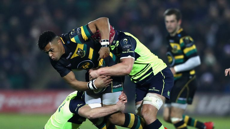 Luther Burrell is brought to ground by the Leinster defence
