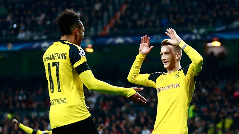 Marco Reus (R) scored late on to secure Dortmund a draw