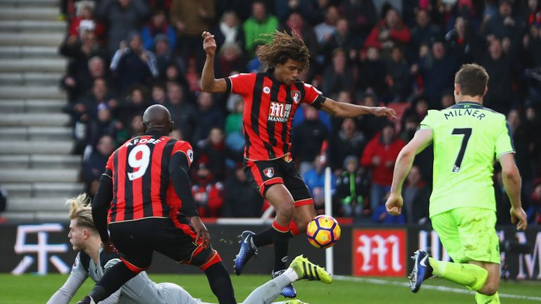 Loris Karius (left) spilled Steve Cook's shot, allowing Bournemouth's Nathan Ake to score the winner in a 4-3 win