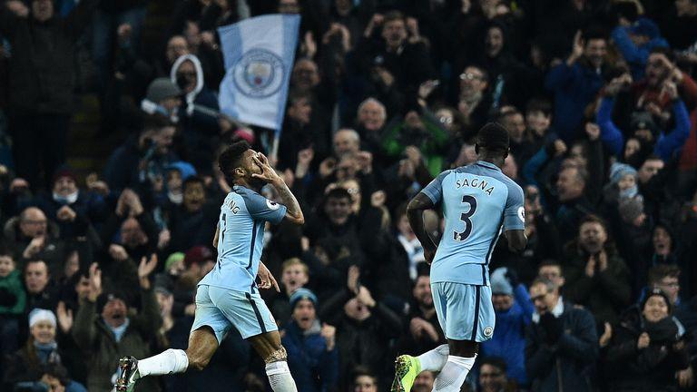 Raheem Sterling celebrates scoring City's winning goal