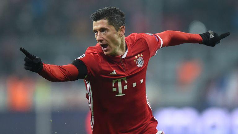 Bayern Munich striker Robert Lewandowski celebrates scoring the opening goal