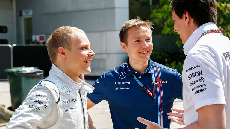 Wolff with Bottas and his trainer, Antti Vierula, at last year's Malaysia GP
