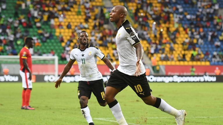 Ghana's forward Andre Ayew celebrates with Mubarak Wakaso after scoring against Uganda